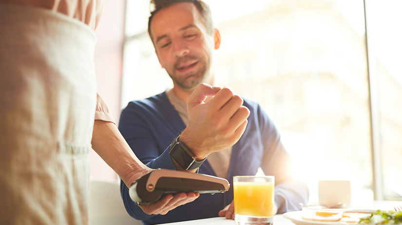 man making payment through smart watch